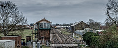 March weather (Peter Leigh50) Tags: march station signal semaphore level crossing box cabin shed goods class 66 gbrf freight fujifilm fuji train trees track town railway railroad rail road car people yard xt10