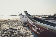 Docked at Morjim Beach (nahinmiah93) Tags: beach boat boats sea sky fishermen people peaceful nature beautiful goa sand scene india vacation sunny seaside coast shore birds