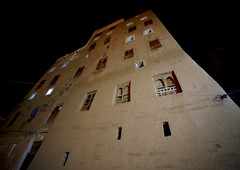 Night View Of A Five Storey House In Shibam, Yemen (Eric Lafforgue) Tags: arabia arabiafelix arabianpeninsula arabic architectural architecture brick builtstructure colourpicture facade fortifiedwall hadhramaut hadhramawt hadhramout hadramaout hadramaut hadramawt historical history horizontal house housing manhattanofthedesert middleeastern mudbrick night nightshot nopeople outdoors placeofinterest shibam skyscraper themanhattanofthedesert town traveldestinations unescoworldheritagesite yemen mg6071
