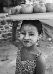 Burmese Girl Selling Coconuts , Ngapali, Myanmar (Eric Lafforgue) Tags: 67years asia asian beautifulpeople blackandwhite burma carrying cheek child childwork childrenonly day decoration exoticism face facepowder grainy innocence lookingatcamera makeup myanmar ngapali onegirlonly oneperson outdoors paintedface pattern photography portrait suncream thanaka tourism traditionalculture traveldestinations trix vertical waistup leicaburma295 rakhinestate