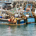 Hard worked fishing boats in Brixham harbour