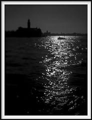 light on the lagoon (Andrew C Wallace) Tags: lagoon reflections venice venezia italy italia blackandwhite bw infrared ir microfourthirds m43 olympusomdem5mk2 tiltshift thephotontrap monochrome boat ferry church