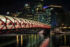 Peace Bridge crossing the Bow River in Downtown Calgary Canada (PhotosToArtByMike) Tags: peacebridge calgary albertacanada alberta night lowlight downtowncalgary canadiancity downtown town city provinceofalberta bowriver elbowriver
