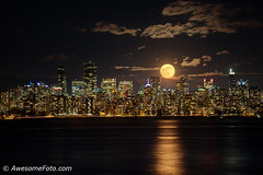 Moonrise above Downtown Vancouver (james c. (vancouver bc)) Tags: night waninggibbous america bc purple britishcolumbia canada city cityscape colorful destination evening highrises moon nature pacificnorthwest reflection scene scenery scenic sea sky tourism touristic travel vancouver view westcoast mountain winter color colour leaf water downtown skyscraper cloud orange bright skyline beautiful fullmoon supermoon building background harvestmoon jericho beach
