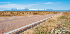 The long and Not-So-Winding Road (Thomas Henneman) Tags: landscape mountains outdoor spanishpeaks blue colorado desolate distant eastern highway lajunta nature orange outside plains prairie road rockies rockymountains vanishingpoint walsenburg yellow usa grass sky mountain vista space