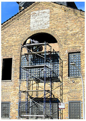 Caught In The Act of Closing A Loophole (swanksalot) Tags: brick window construction workers strangers hubbardstreet wall tweeted chicago