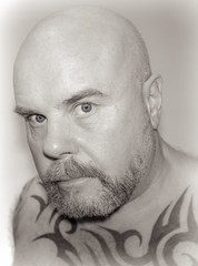 Tattoos and eyes. (CWhatPhotos) Tags: cwhatphotos camera photographs photograph pics pictures pic picture image images foto fotos photography artistic that have which contain flickr olympus pen ep5 self selfie portrait me this art bw mono black white man male he beard goatee pose poser eyes sepia