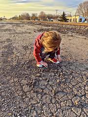 Discovering our broken world (Pejasar) Tags: light hour golden discovery feel touch asphalt crumbling brokenworld discover grandson child boy