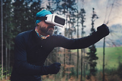 person wearing black henley shirt and white vr goggles 756439 (imagesman) Tags: action adult augmentedreality beard boxing boy daylight equipment forest game landscape light man outdoors outfit park person pose position recreation sportsequipment technology trees virtual virtualreality virtualrealityglasses virtualrealitygoggles virtualrealityheadset vr wear