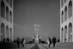 Worlds turned upside down (parenthesedemparenthese@yahoo.com) Tags: dem bn city couple eur42 femme hiver man mirror monochrome nb noiretblanc roma rome street textures woman blackandwhite bnw byn canon600d colisã©ecarrã© december decembre ef24mmf28 ernestolapadula giovanniguerrini homme italia italy marioromano miroir palaisdelacivilisationitalienne palazzodellacivitaitaliana reflecion streetphotography walk winter