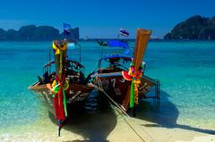 Colourful longtail boats, Thailand (Bokeh & Travel) Tags: longtail boats boat thai thailand beach colorful seascape seasideview sea tropical paradise vacation beautiful naturalbeauty sand landscape island colourful