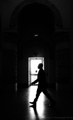 (Luther Roseman Dease, II) Tags: monochrome bw silhouette contrejour walking guard darkened light doorway archway angle lowkey noireetblanc negroyblancofotografie fineartphotography blackandwhitephoto candid shadow motion highcontrast humanelement lines depth framing form fotografie photography art unposed atmosphere urgency duty backlit neighbor negativespace blackwhite blackwhiteblack space perspective aspect size philadelphia