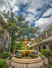 A place for prayer and contemplation (FotoGrazio) Tags: filipinos color travelphotography water fotograzio buildings quiet photoeffect meditation religion hdr belief basilicadelsantoniño christian waynegrazio scenic sky kids waterfountain visayas prayer placetopray phototoart streetscene photomanipulation architecture streetphotography lovely plants courtyard people street highdynamicrange architecturalphotography catholic philippines tree clouds garden balcony spanishcolonialism fountain waynestevengrazio beautiful travel romancatholic waynesgrazio filipino faith scenery family tourism tropical cebu