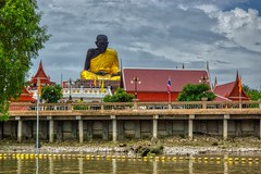 Statue of a famous monk by the Mae Klong river near Amphawa, Samut Songkhram, Thailand (UweBKK (α 77 on )) Tags: statue monument temple wat monk famous mae klong river water flow clouds sky grey stream building architecture amphawa samut songkhram thailand southeast asia sony alpha 77 slt dslr