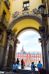 madrid013 (by claudine) Tags: capturedbylight l16 light16 architecture spain madrid los heroes del 7 de julio 1822 arch archway entrance square yellow orange tourism tourist people street sign storefront windows balconies plazamayor