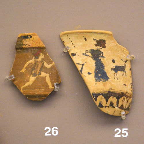 Fragments of Black Figure krateriskoi depicting girls racing or dancing during the Arkteia