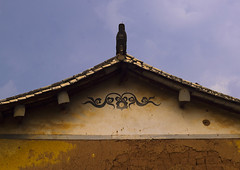 Old Mongolian House In Tong Hai, Yunnan Province, China (Eric Lafforgue) Tags: a0006836 ancient asia carving china chineseculture colorpicture history horizontal house moghul mongolian nopeople old outdoors roof tonghai traditionalculture yunnan yunnanprovince