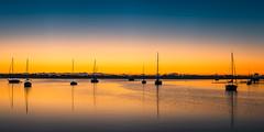 Dawn in the harbor (Ed Rosack) Tags: usa landscape calm riverscape dawn sailboat ©edrosack panorama florida dock river water centralflorida sky boat harbor sunrise cocoa reflection us