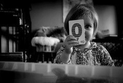 Learning the Letters (gunnisal) Tags: girl child alphabet letters bw blackandwhite monochrome gunnisal