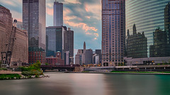 Sunrise along the Riverwalk (tquist24) Tags: chicago chicagoriver chicagoriverwalk hdr illinois nikon nikond5300 architecture city clouds geotagged longexposure morning river sky skyscraper skyscrapers sunrise water