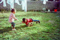 Playground (hiphopmilk) Tags: copyright©jaredyehwooehmoehfilms konica offroad 現場監督 zoom 35mm 135film film analog analogue jaredyeh hiphopmilk kodak travel china sichuan aba hongyuan tibetan qiongxi village yard workshop kids children playground seesaw bricks