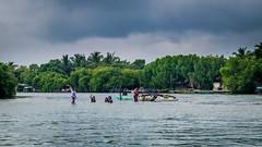 happy family - Negombo lagoon (tattie62) Tags: srilanka negombo lagoon family sisters girls beautiful happy fun water boat bathing trees forest jungle mangroves travel tourism waving greeting friendly