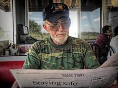 American Veteran, Master Mechanic (Chris Yarzab) Tags: americanveteran usaf vietnam godblessamerica hat beard readingthepaper glasses camouflage 74yearsold midsouthmemories diner dive foodjoint cafe bifocals pregnantguppy disabledveteran