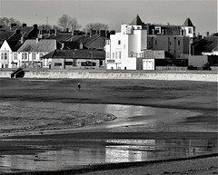 Promenade Buildings and Beach - Newbiggin-By-The-Sea (Gilli8888) Tags: nikon p900 coolpix northumberland newbigginbythesea newbiggin northsea beach sand coast coastal shore seaside seascape sun dawn sea water marine blackandwhite promenade buildings architecture reflections reflectionsinwater