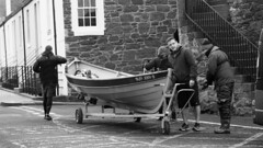 This Used Car Is Not What I Thought It Was (byronv2) Tags: peoplewatching candid street blackandwhite blackwhite bw monochrome northberwick rnbforth firthofforth river riverforth sea northsea scotland coast coastal boat rowboat skiff harbour