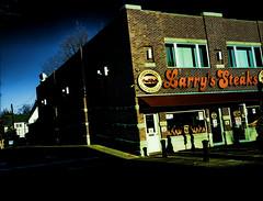 Larry's Steaks (raymondclarkeimages) Tags: rci raymondclarkeimages usa flickr google process processed outdoor streetphotography 8one8studios street food philly sandwiches cheesesteak phillycheesesteak bellyfiller hoagies larrys overbrook stjoes restaurant xseries xt3 apsc mirrorless fujifilm xf23mmf14r sign building sky larryssteaks store