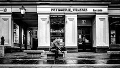 Table for one. (Mister G.C.) Tags: blackandwhite bw image streetshot streetphotography photograph candid people woman outdoors bench seat patiesserievalerie cafe unposed monochrome urban town city sonya6000 sonyalpha a6000 mirrorless zoom lens mistergc schwarzweiss strassenfotografie glasgow scotland europe kitlens 16mm50mm selp1650
