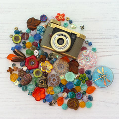 In the midst of it (hehaden) Tags: camera vintage subminiature pete walterkunik glassbuttons beads colourful tabletop miniature photoboard square sel55f18z