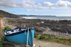 Blue boat at Portwrinkle, Cornwall (Baz Richardson) Tags: cornwall whitsandbay rockshelves smallboats ramepeninsula portwrinkle coast cliffs