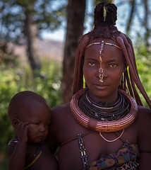 Himba mother and child (loveexploring) Tags: africa erembe himba himbatribe himbawoman kaokoland namibia hairstyle jewelry mother motherandchild portrait woman