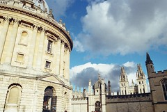 Rdcliffe Camera and Hertford College (cycle.nut66) Tags: film kodak colr plus 200 analogue scan tamron 2825 olympus om2 sky clouds bright light sunlight 2019 classic radcliffe camera hertford college oxford university