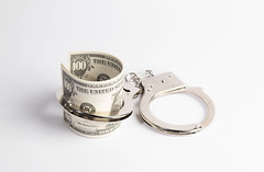 Handcuffs and money (wuestenigel) Tags: us crime money dollar handcuffs fraud bussiness lock steel law cash isolated isoliert wealth reichtum noperson keineperson desktop luxury luxus jewelryband schmuckband currency währung stehlen jewelry schmuck security sicherheit closeup nahansicht business geschäft achievement leistung disjunct disjunkt reflection reflexion glazed glasiert gold fashion mode shining leuchtenden geld