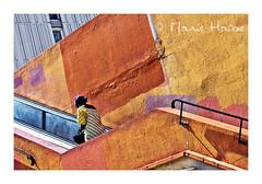 le mur était orange (3) (Marie Hacene) Tags: paris olympiades orange mur escalator passant