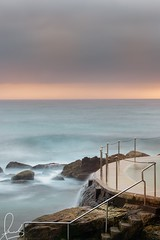 Bronte Baths pastels. A long exposure at around sunrise on a warm muggy summer morning January 2019. Bronte is a beachside suburb in eastern Sydney. (sachman75) Tags: bronte beach brontebeach brontepool longexposure sunrise sydney australia nsw newsouthwales oceanpools leefilters sonya7rii canon70200mmf4 swimmers