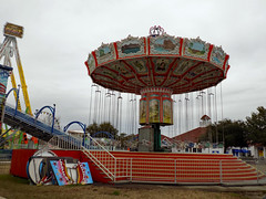Wave Swinger. (dccradio) Tags: myrtlebeach sc southcarolina horrycounty broadwayatthebeach outdoor outdoors outside carnival midway fairride amusements amusementdevice mechanicalride ride rides thrillride outdooramusement fun entertainment sky cloudy overcast greyskies grayskies amusementpark park february winter monday mondaymorning morning goodmorning pendulumride thebeast stairs swings swingride carnivalswings waveswinger steps rail railing slide funslide carnivalslide giantslide superslide grass lawn browngrass scenerypanels nikon coolpix l340 bridgecamera pavilionpark pavilionparkcentral pavilionamusementpark pavilionamusementparkcentral