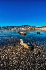 Stone Cold & Ducks (orkomedix) Tags: canon eosr samyang 14mm efadapter bavaria tegernsee water mountains ducks stone sky clear
