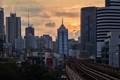 Bangkok – Early morning (Thomas Mülchi) Tags: 2019 bts btsstation bangkok pathumwandistrict phloenchit thailand buildings cityscape earlymorning highrise railwaytracks sunrise bangkokmetropolitanregion th