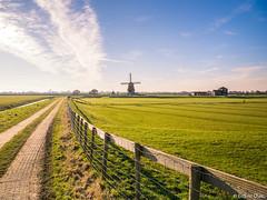 Polder landscape in Holland (✦ Erdinc Ulas Photography ✦) Tags: dutch holland polder landscape panasonic travel windmill nederland netherlands green farm grass clouds sky etersheim village road mill windmolen