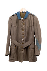 Nina Last's Women's Hospital Corps orderly's jacket, c1915 (LSE Library) Tags: suffrage suffragette suffragettes votes women equality politics vote democracy uk britain wspu jacket hospital corps endell street tailored brown khaki material blue collar trimmings ten buttons belt two pockets sleeve four rows braiding rank nina last served nurse orderly nursing military founded members royal army medical ramc staff female staffed 1915 first world war one great ww1 wwi london covent garden