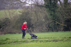 DSC_5066 Scawby North Lincolnshire Lady in Red Sweater Cutting the Grass on the Public Right of Way used by Dog Walkers (photographer695) Tags: scawby north lincolnshire lady red sweater cutting grass public right way used by dog walkers