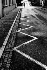 Zig Zag (Nikon F80) (stefankamert) Tags: zigzag street lines contrasts people blur blurry textures zickzack film analogue analog grain nikon f80 nikonf80 voigtländer ultron noir noiretblanc blackandwhite blackwhite bw kodak trix