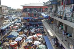 Clothes market (Francisco Anzola) Tags: ghana accra africa city market tudumarket parasols shops building construction people