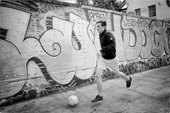 Born to Kick Balls (Steve Lundqvist) Tags: soccer kid guy boy ball football footpath sidewalk wall painting art action location english london londra inghilterra england uk britain british street streetphotography fashion moda mood bruce weber
