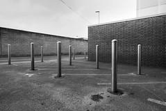 uprising (chrisinplymouth) Tags: ground pavement bollard steel metal wall perspective cattedown plymouth devon england uk cw69x diagx diagonal plain