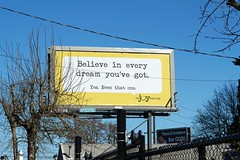 Believe ..... (Eclectic Jack) Tags: optimisic optimism dreams believe bill board billboard yellow blue sky skies sign fence tree message inspire inspiration od