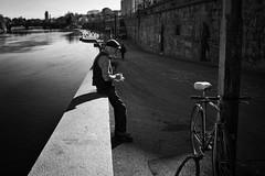 Cigarette break (Roberto Spagnoli) Tags: fotografiadistrada streetphotography biancoenero blackandwhite bw people bicycle bicicletta river lightsandshadows cigarette smoke pause stillness italy